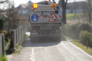A road sweeper hired in Inverness performing road maintenance